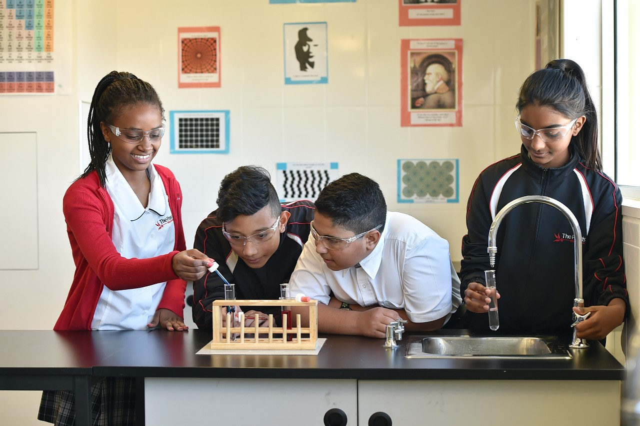 Students completing a science practical